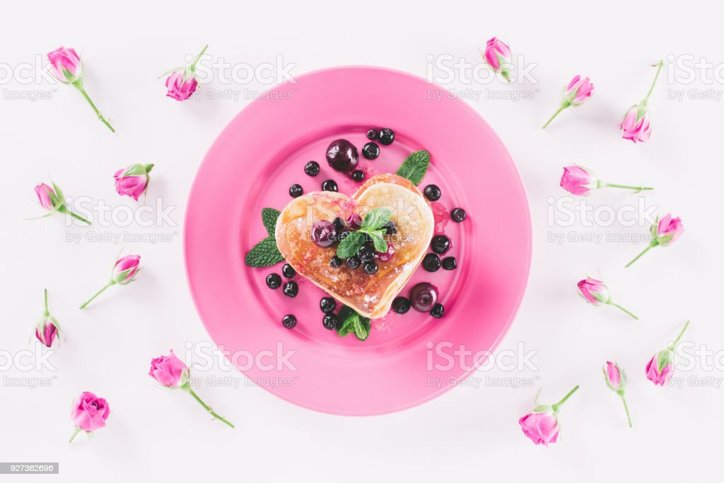 top view of heart shaped pancake and pink roses isolated on white, valentines day concept - Royalty-free Baking Stock Photo