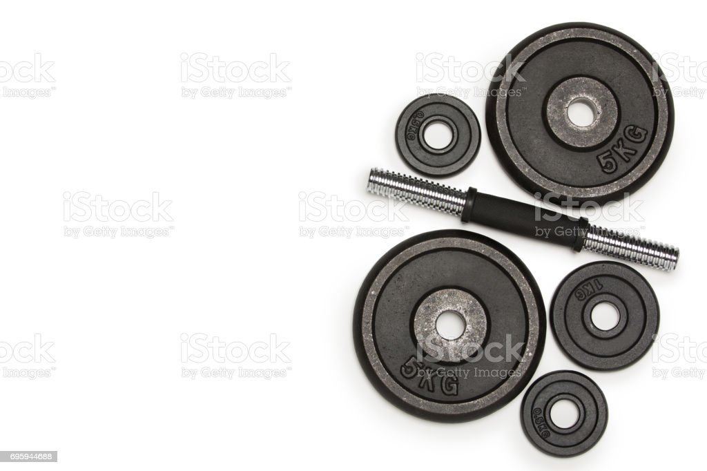 Top view of heavy weight plates with iron bar isolated on white stock photo