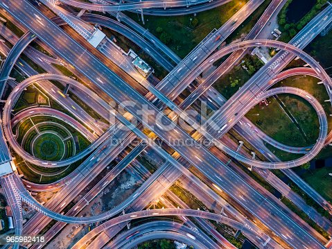 istock Top view of Highway road junctions at night. The Intersecting freeway road overpass the eastern outer ring road of Bangkok, Thailand. 965962418