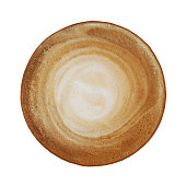 Top view of hot coffee cappuccino with spiral milk foam or stirred coffee texture isolated on white background, clipping path included.