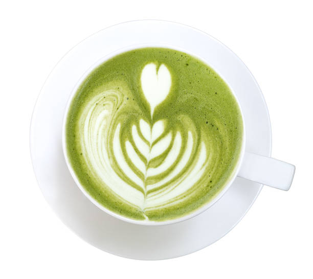 Top view of hot matcha green tea latte art foam isolated on white background, clipping path included stock photo