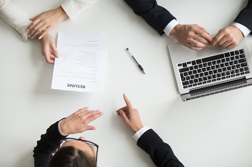 istock Top view of HR managers interviewing female applicant 955158538