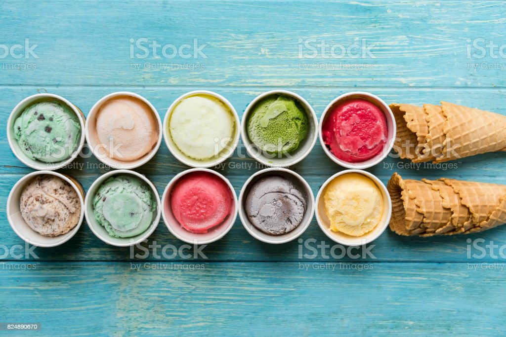 Top view of Ice cream flavors in cup and ice cream cone waffle, sweet and dessert food concept stock photo