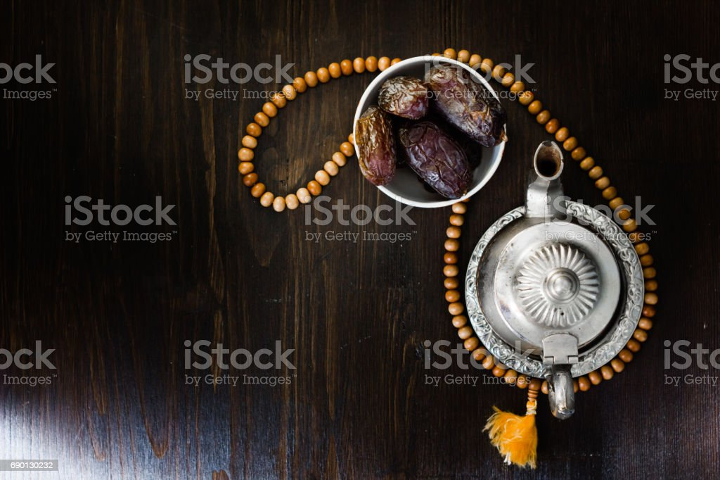 Top view of iftar fruit - dates and islamic rosary. stock photo