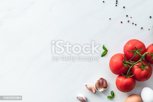 top view of ingredients for cooking omelette for breakfast on white marble surface