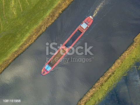Top down view on inland cargo ship in dutch canal