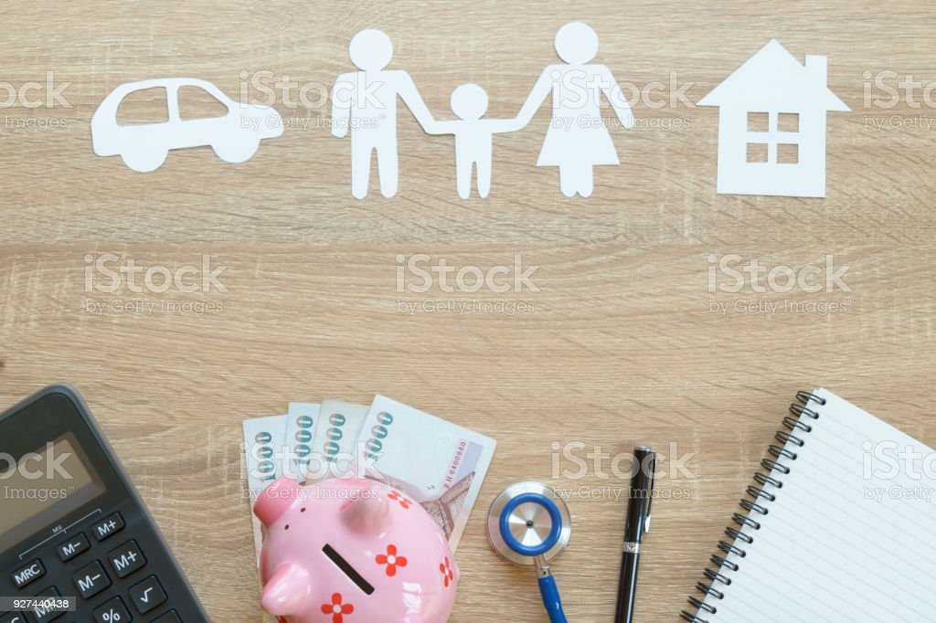 Top view of insurance concept with family, car, house paper,...