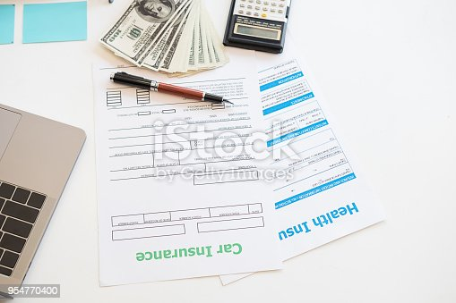 istock top view of insurance contract and money on table,insurance car and health concept. 954770400