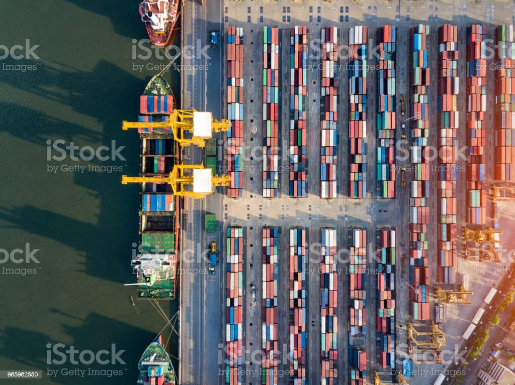 Top view of international port with Crane loading containers in import export business logistics. - Royalty-free Aerial View Stock Photo