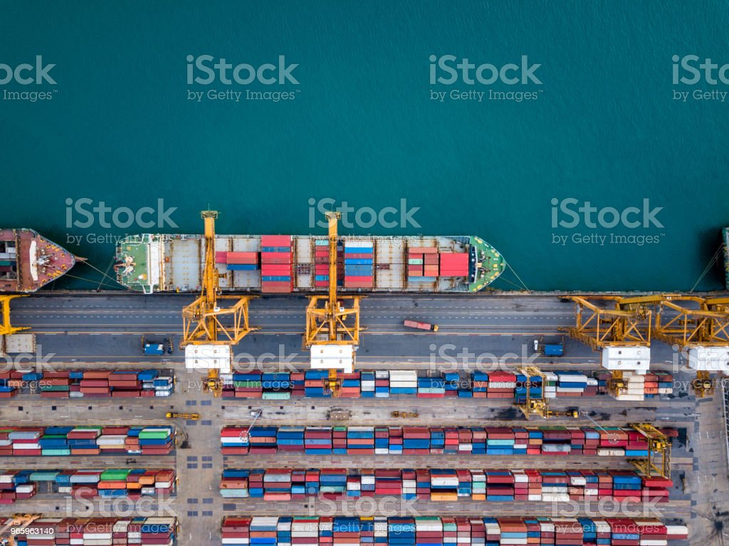 Top view of international port with Crane loading containers in import export business logistics. royalty-free stock photo