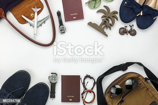 istock Top view of items for travel with fashion men & women background concept.Difference essential accessory on the white wood area.Copy space for creative font or text design.Objects for traveler on trip. 862254756