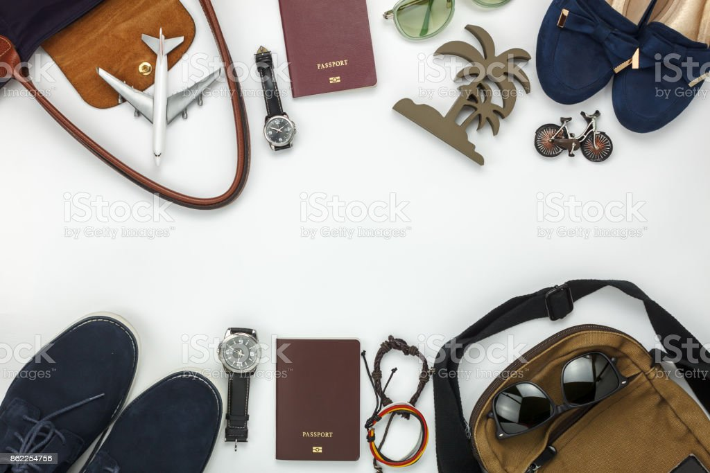 Top view of items for travel with fashion men & women background concept.Difference essential accessory on the white wood area.Copy space for creative font or text design.Objects for traveler on trip. stock photo
