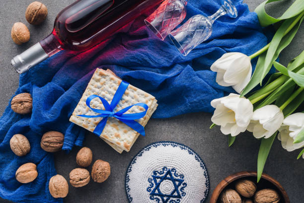 top view of kippah, matza and wine, jewish Passover holiday concept top view of kippah, matza and wine, jewish Passover holiday concept passover stock pictures, royalty-free photos & images