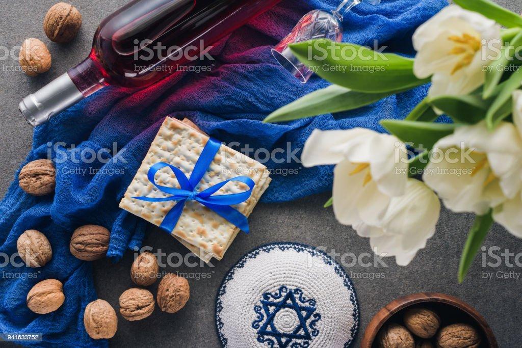 top view of kippah, matza and wine, Pesah celebration concept stock photo