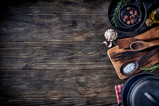 Top view of kitchen utensils on rustic table with copy space. Vintage themes