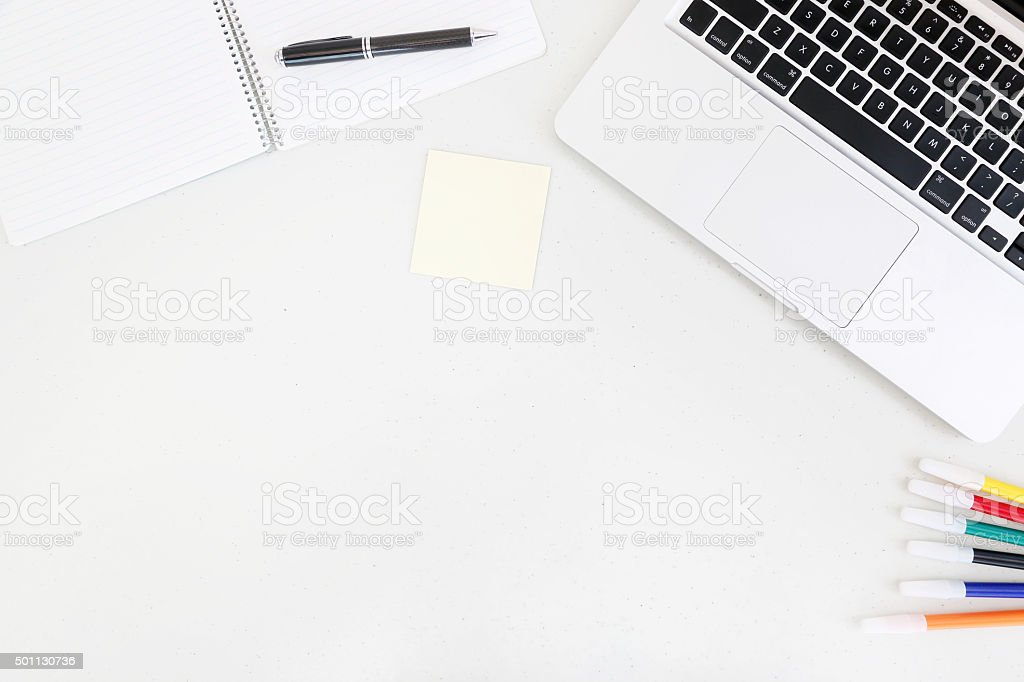 Top view of laptop and blank notebook with copy space stock photo