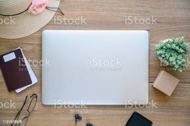 Top view of laptop passport hat glasses and smartphone on wooden picture id1131579378?b=1&k=6&m=1131579378&s=612x612&h=0z8hsnlw69erwuqujhggbbamf gcvrbd5nzxagqd5s0=