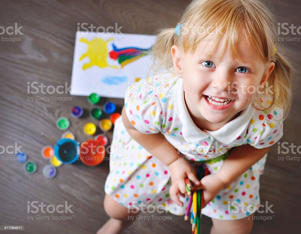 Top view of Little Girl with colored pencils. stock photo