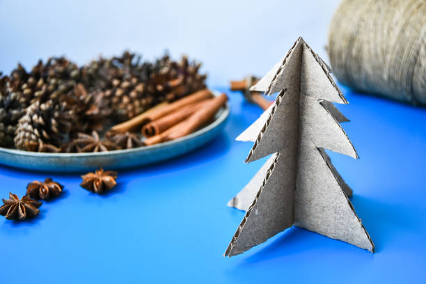 Top view of Making little Christmas tree of cardboard. Children's art project, a craft for children. DIY concept. Step by step 6 stock photo