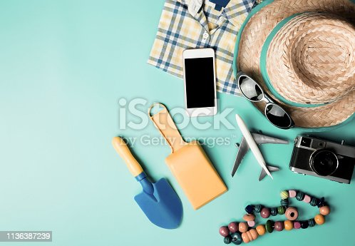 665586146 istock photo Top view of male vacations Beach fashion summer holidays accessories on pink pastel color background 1136387239