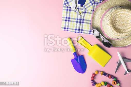 665586146 istock photo Top view of male vacations Beach fashion summer holidays accessories on pink pastel color background 1136387283
