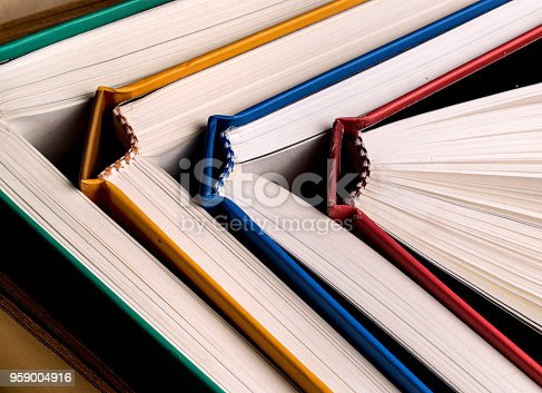istock Top view of many books, aligned and colorful, full frame closeup 959004916