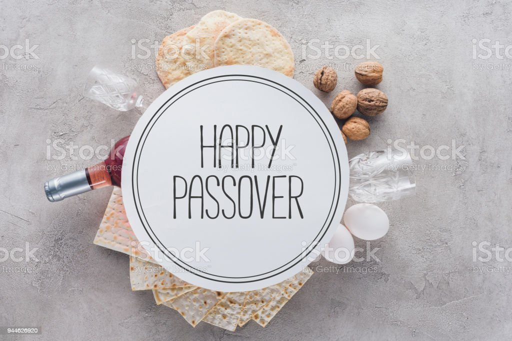 top view of matza and plate with happy passover greeting, jewish Passover holiday concept stock photo