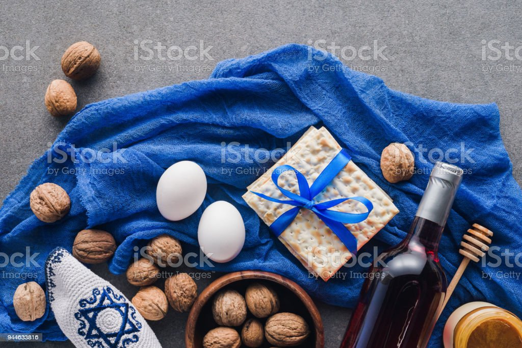 top view of matza, eggs and wine on table, Passover Tale concept stock photo