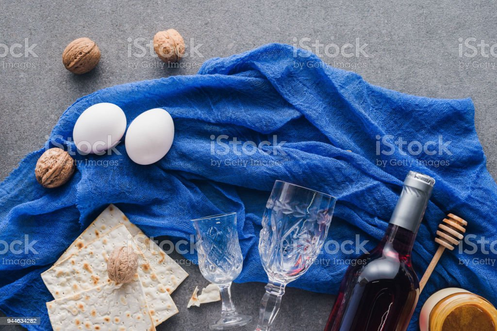 top view of matza, honey and wine on table, Passover Tale concept stock photo