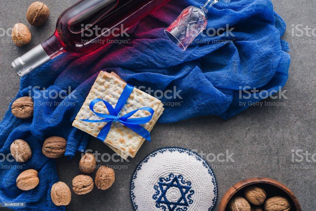 top view of matza, kippah and wine, jewish Passover holiday concept stock photo