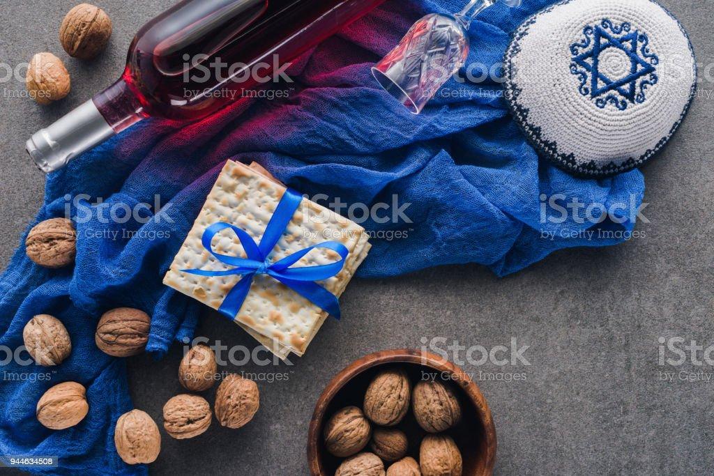 top view of matza, kippah and wine, Pesah celebration concept stock photo