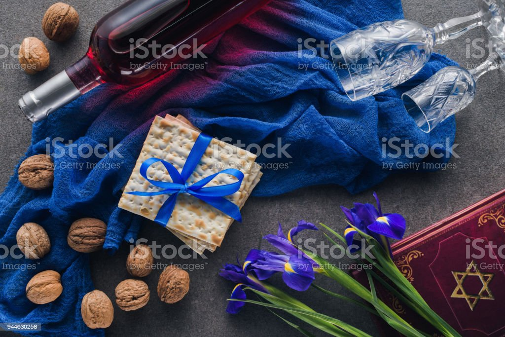 top view of matza, torah and wine on table, jewish Passover holiday concept stock photo