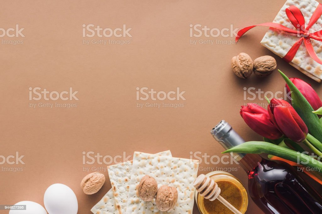 top view of matza, wine and honey on brown table, Passover Haggadah concept stock photo