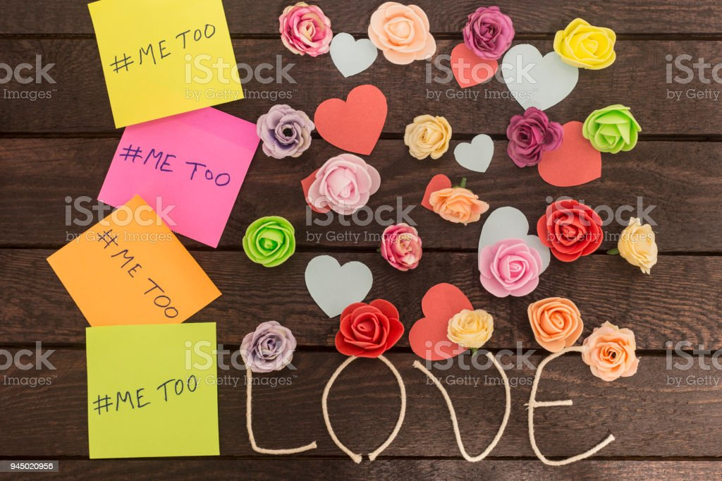 top view of Me too message written in colorful stickers on a love knoted background stock photo