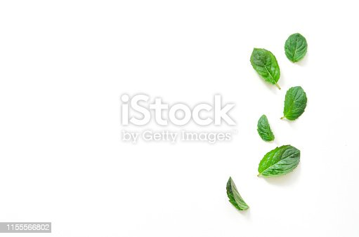 Top view of mint herbs on white background. - Image