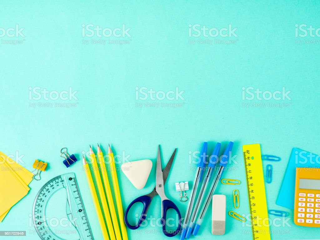 Top view of modern bright blue office desktop with school supplies on table, empty space for text. Back to school concept. stock photo