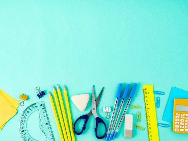 top view of modern bright blue office desktop with school supplies on table, empty space for text. back to school concept. - school supplies stock pictures, royalty-free photos & images