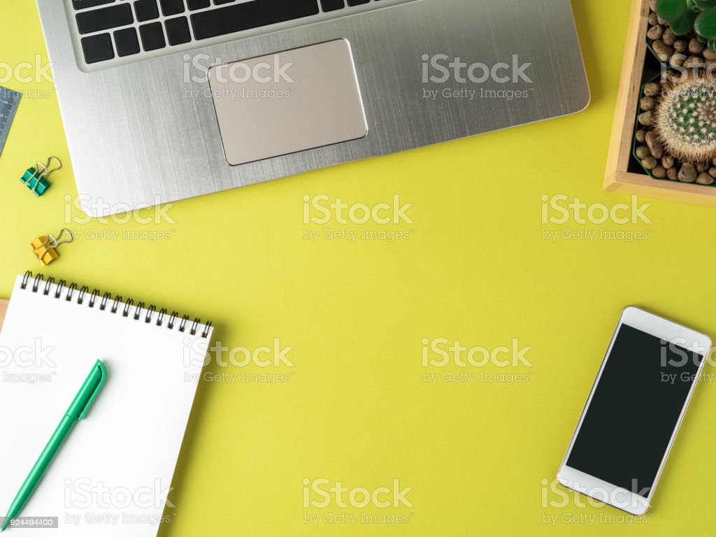 Top View Of Modern Bright Yellow Office Desktop With Blank Notepad Computer  Smartphone Cactus Succulent Mock Up Empty Space Stock Photo & More
