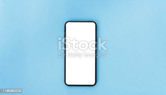 istock Top view of modern technology smart phone mobile on blue background 1195362220
