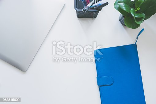 istock Top view of modern work space office desk 965815602