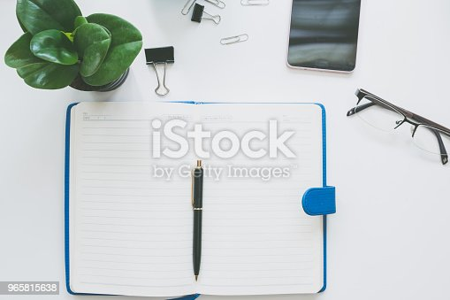 istock Top view of modern work space office desk 965815638