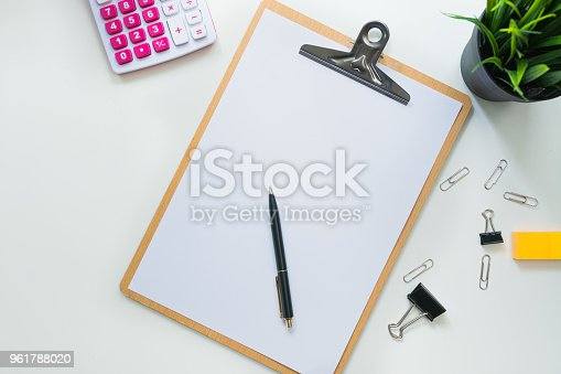 istock Top view of modern work space office desk table with computer , pen and copy space 961788020