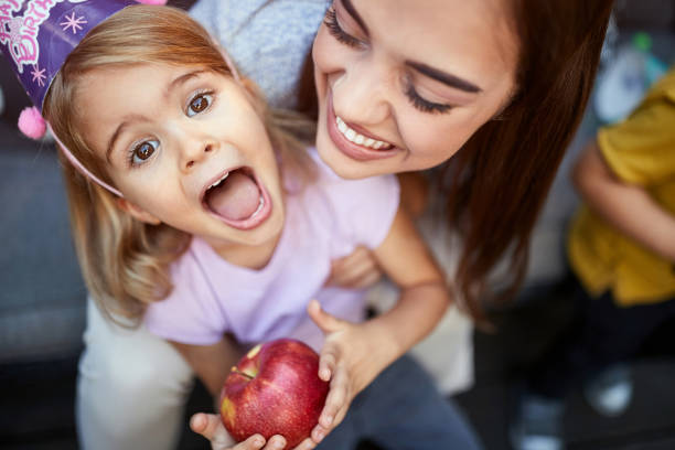 Top view of mother with daughter Top view of mother with daughter with apple birthday wishes for daughter stock pictures, royalty-free photos & images