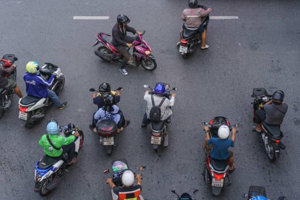 Top view of motorbikes in traffic jam in Bangkok, Thailand. stock photo