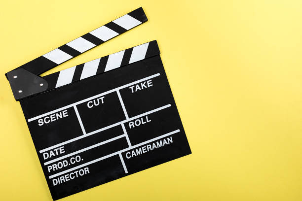 top view of movie clapper board on yellow stock photo