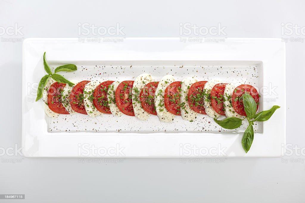 top view of mozzarella cheese with sliced tomatos stock photo