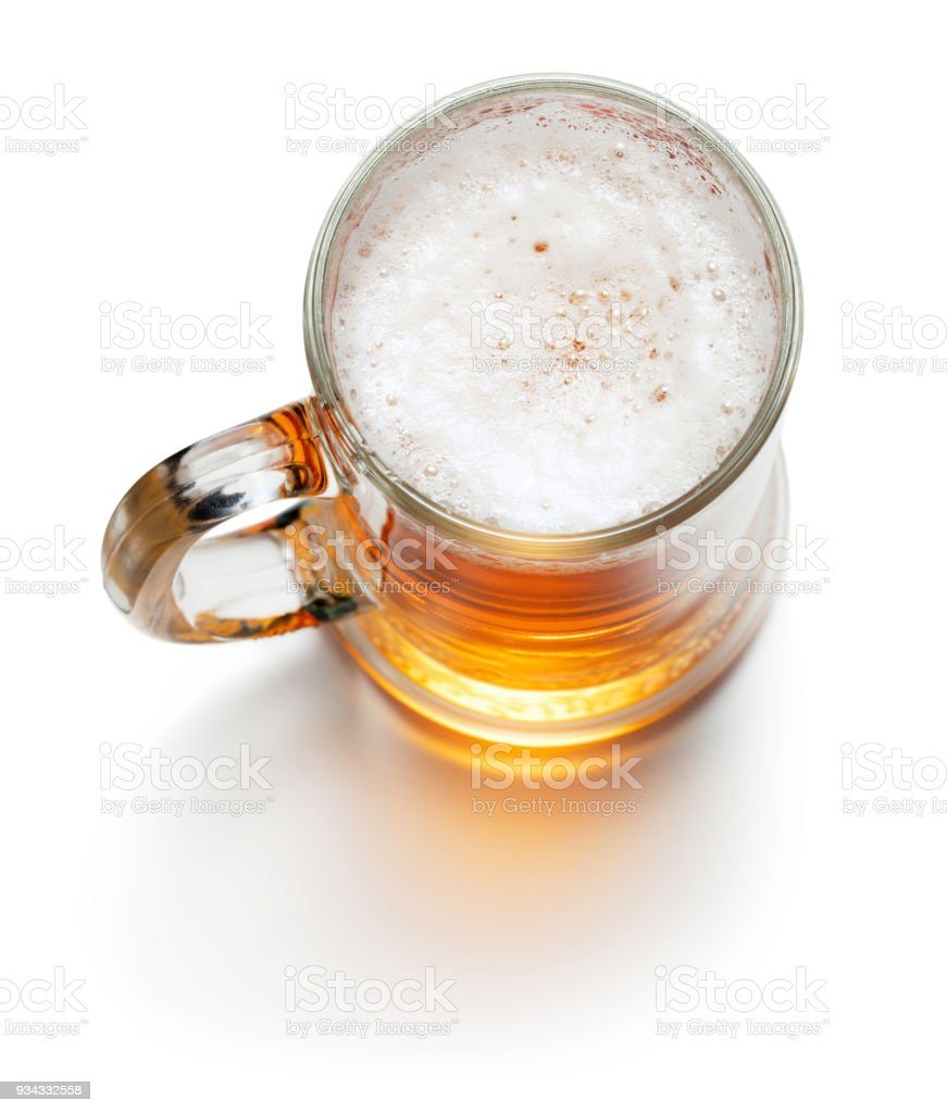 top view of mug of light beer isolated on white background stock photo