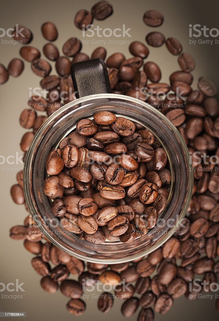 Top view of mug with coffee beans royalty-free stock photo