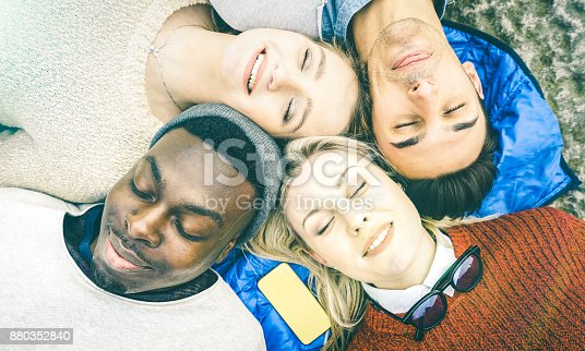 861023492istockphoto Top view of multiracial best friends having fun resting together outdoors on sunny day - Happy friendship and peace concept with young multicultural people on relax mood - Bright vintage filtered look 880352840