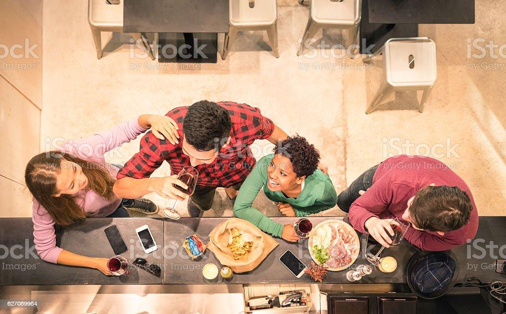 Top view of multiracial friends tasting wine and having fun - foto de acervo